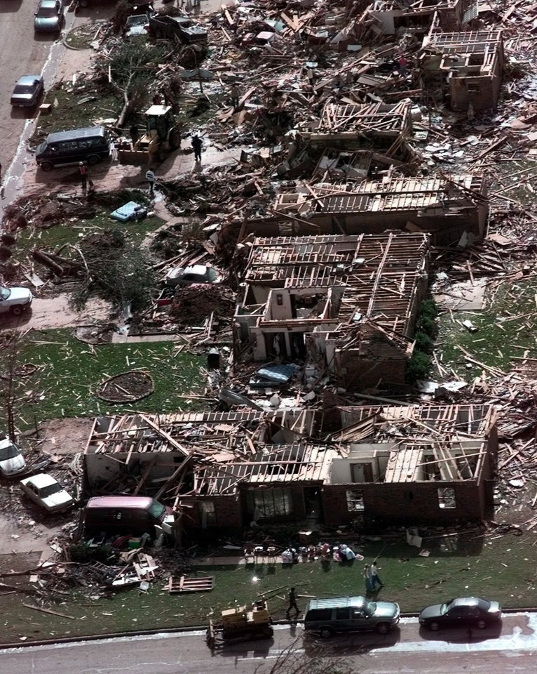 Photo - FILE - In this Tuesday, May 4, 1999, photo, a neighborhood in Moore, Okla., lays in ruins pm Tuesday, May 4, 1999, after a tornado flattened many houses and buildings in central Oklahoma, Monday, night. The powerful tornado in suburban Oklahoma City Monday, May 20, 2013, loosely followed the path of a killer twister that slammed the region in May 1999. (AP Photo/J. Pat Carter, File)