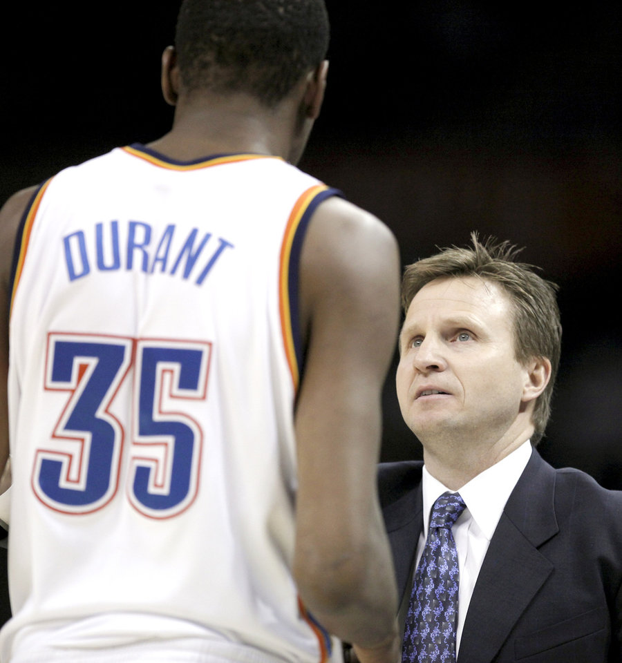Photo - Oklahoma City head coach Scott Brooks talks to Kevin Durant during a timeout during the NBA game between Oklahoma City and San Antonio, Tuesday April 7, 2009, at the Ford Center in  Oklahoma CIty. Photo by Sarah Phipps, The Oklahoma