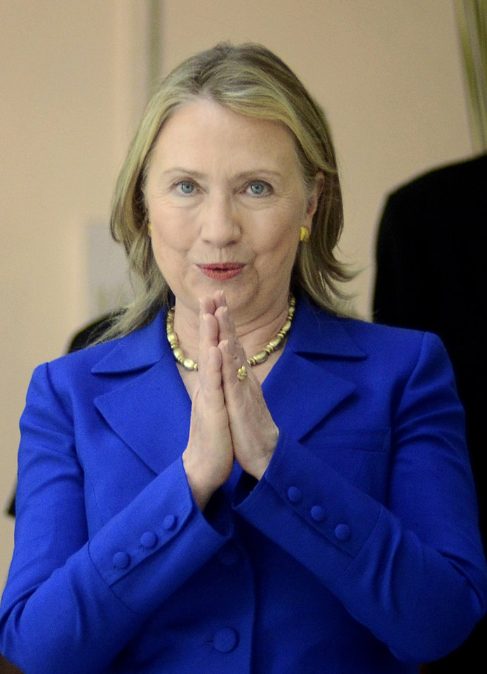 Photo -   U.S. Secretary of State Hillary Rodham Clinton gestures with a traditional Indian