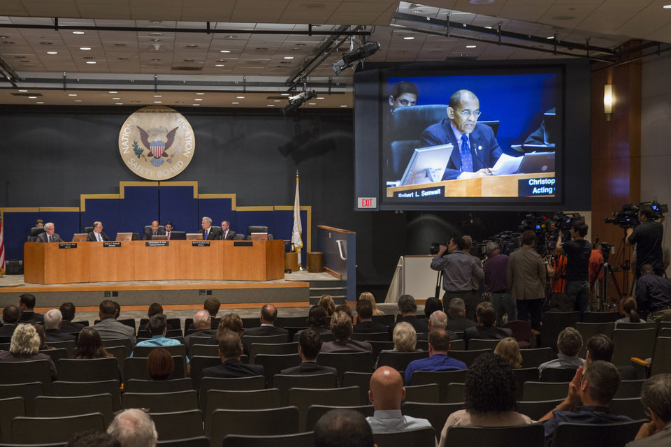 Photo - Acting National Transportation Safety Board (NTSB) Chairman Christopher Hart makes opening remarks during an NTSB hearing to establish the cause of the Asiana Flight 214 airlines crash in San Francisco, and to make safety recommendations, Tuesday, June 24, 2014, in Washington. (AP Photo/ Evan Vucci)