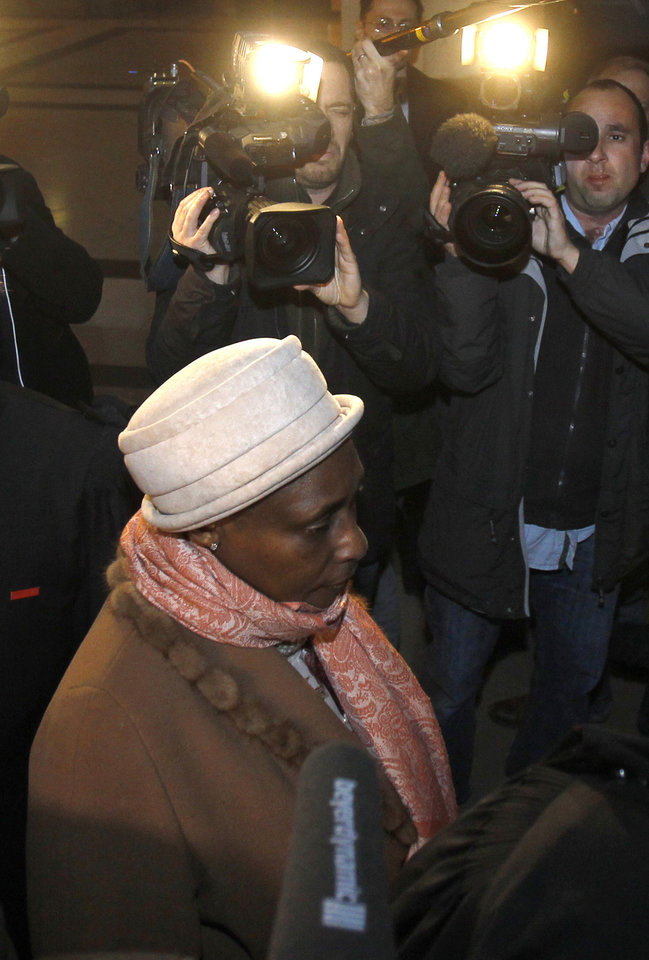 Photo -   Agathe Habyarimana, the widow of former President of Rwanda Juvenal Habyarimana, arrives at a Paris court house, Tuesday, Jan. 10, 2012. A French investigator is releasing the results of his investigation Tuesday into the downing of the plane of President Juvenal Habyarimana, which helped spark Rwanda's 1994 genocide. (AP Photo/Remy de la Mauviniere)