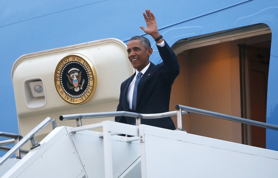Photo - U.S. President Barack Obama steps off Air Force One as he arrives in Tallinn, Estonia, Wednesday, Sept. 3, 2014, for a one day visit where he will meet with Baltic State leaders before heading to the NATO Summit in Wales. (AP Photo/Charles Dharapak)