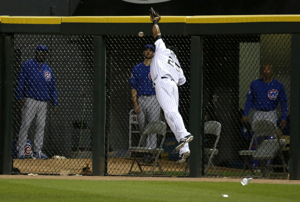 Photo - Chicago White Sox right fielder Moises Sierra is unable to catch a long fly ball off the bat of Chicago Cubs' Anthony Rizzo during the eighth inning of an interleague baseball game Thursday, May 8, 2014, in Chicago. (AP Photo/Charles Rex Arbogast)