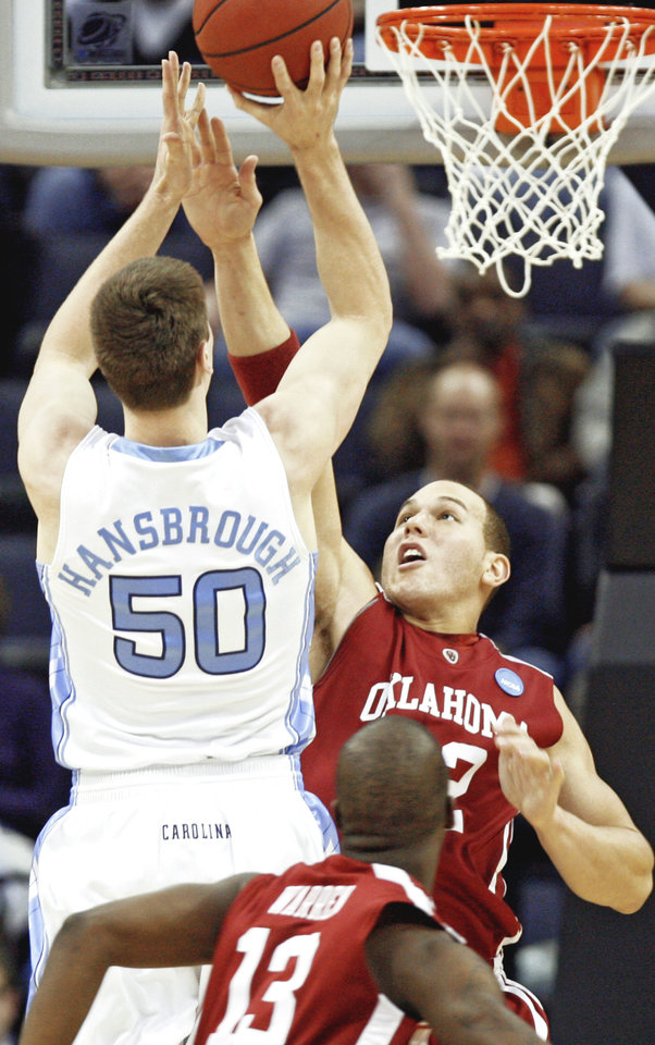 Oklahoma's Taylor Griffin, right, tries to defend on North Carolina's Tyler Hansbrough during the first half at the FedExForum on Sunday.  PHOTO BY CHRIS LANDSBERGER, THE OKLAHOMAN