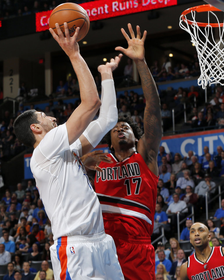 Photo - Oklahoma City's Enes Kanter (11) shoots against Portland's Ed Davis (17) during an NBA basketball game between the Oklahoma City Thunder and the Portland Trailblazers at the Chesapeake Energy Arena in Oklahoma City, Monday, March 14, 2016. Photo by Nate Billings, The Oklahoman
