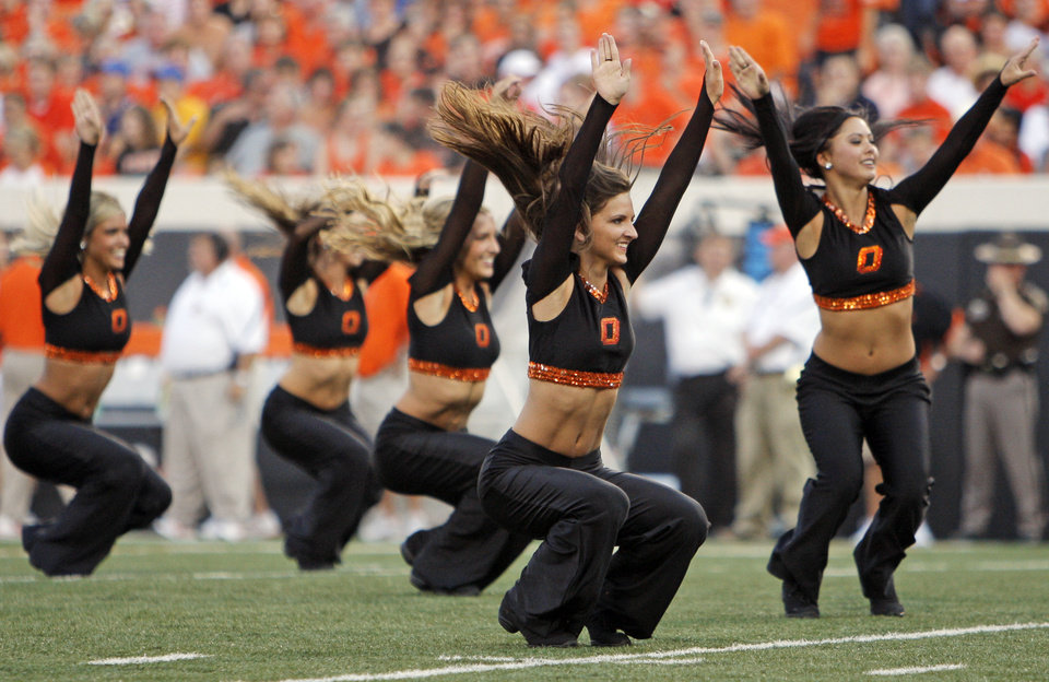 Photo - The OSU pom squad performs during the college football game between the University of Tulsa (TU) and Oklahoma State University (OSU) at Boone Pickens Stadium in Stillwater, Oklahoma, Saturday, September 18, 2010. Photo by Nate Billings, The Oklahoman