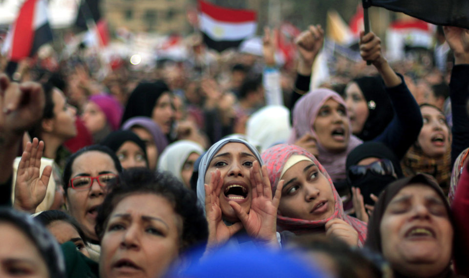 Photo -   Egyptian protesters chant slogans against President Mohammed Morsi in Tahrir Square in Cairo, Egypt, Tuesday, Nov. 27, 2012. Egyptians flocked to Cairo's central Tahrir square on Tuesday for a protest against Egypt's president in a significant test of whether the opposition can rally the street behind it in a confrontation aimed at forcing the Islamist leader to rescind decrees that granted him near absolute powers. (AP Photo/ Khalil Hamra)