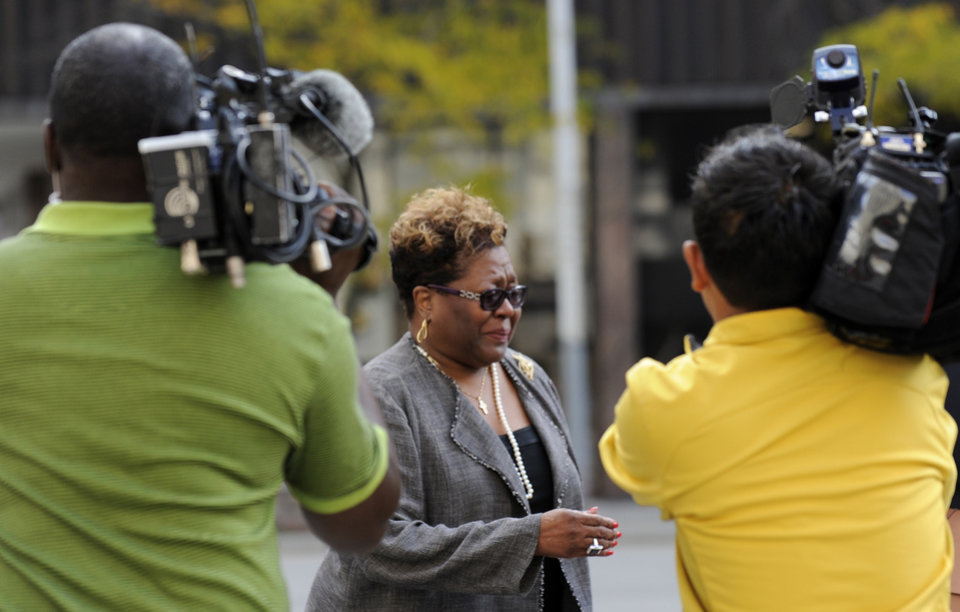 Photo of Emma Bell is followed by media in Detroit on Thursday Oct. 4, 2012. Bell is Kwame Kilpatrick�s longtime fundraiser and testified Kilpatrick's trial Thrusday. (AP Photo/Detroit News,David Coates ) DETROIT FREE PRESS OUT; HUFFINGTON POST OUT