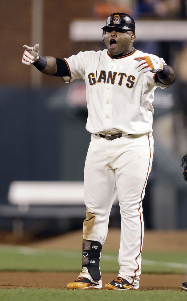 Photo -   San Francisco Giants' Pablo Sandoval celebrates after driving in a run with a single against the Arizona Diamondbacks during the seventh inning of a baseball game on, Tuesday, Sept. 4, 2012 in San Francisco. (AP Photo/Marcio Jose Sanchez)