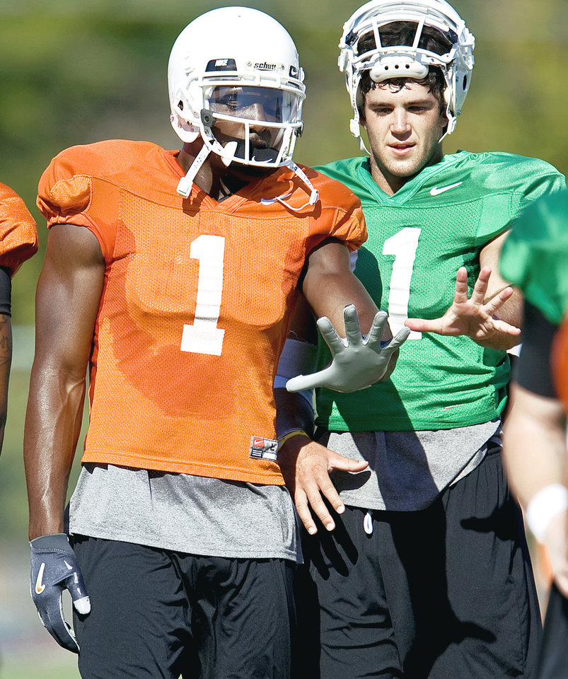 Photo - Dez Bryant, left, and Zac Robinson lead Oklahoma State into its Sept. 5 opener against Georgia. Photo by Bryan Terry, The Oklahoman