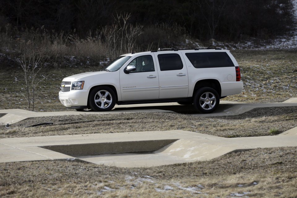 "In a Jan. 17, 2013 photo, a Chevrolet Suburban is driven through the uneven terrain course at the General Motors Milford Proving Grounds in Milford, Mich.  It's in this northwest Detroit suburb that GM has its testing facility, which, according to GM consumer affairs chief James Bell, exists for the purpose of beating ""the heck out of a vehicle before the customer can.� Founded in 1924, the 4,000-acre Milford Proving Grounds was the first dedicated automotive testing facility in the world, and remains one of the largest to this day. (AP Photo/Carlos Osorio)"