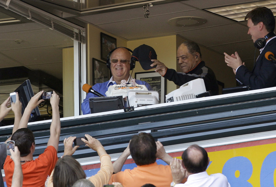 Photo -   Hall of Famer Willie Mays, center top, waves to fans as he is introduced by San Francisco Giants announcers Jon Miller, top, and Dave Flemming in celebration of his 81st birthday during a baseball game against the Milwaukee Brewers in San Francisco, Sunday, May 6, 2012. (AP Photo/Jeff Chiu)