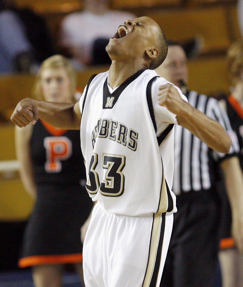 Midwest City's Trael Colbert (33) reacts after a basket during the Class 6A high school basketball state tournament final between Putnam City and Midwest City at the ORU Mabee Center in Tulsa, Okla., Saturday, March 13, 2010. Photo by Nate Billings, The Oklahoman