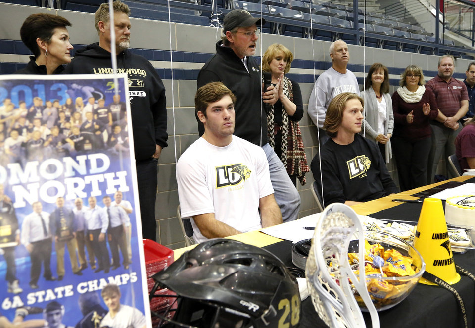 Jake Hobbs, left, and Sam Heaton signed letters to play lacrosse at Lindenwood. Athletes from Edmond North High School signed national letters of intent with colleges and universities during a ceremony in the school's gymnasium Wednesday morning, Nov. 13, 2013. Various sports include golf, softball, wrestling,  lacrosse and others. Photo by Jim Beckel, The Oklahoman
