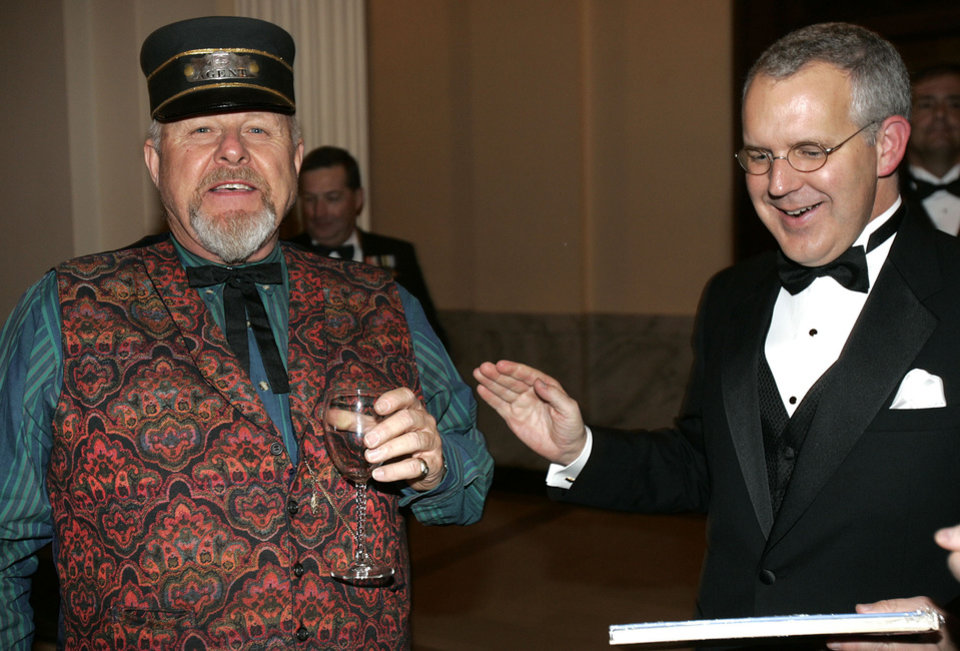 Photo - Oklahoma Gov. Brad Henry shares a moment with Philip Moseley of Guthrie, at the Oklahoma Centennial Statehood Inaugural Ball, Saturday, Nov. 17, 2007, at the Guthrie Scottish Rite Masonic Center, in Guthrie, Okla. By Bill Waugh, The Oklahoman