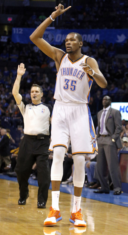 Photo - Oklahoma City 's Kevin Durant (35) celebrates a three pointer during the NBA game between the Oklahoma City Thunder and the Utah Jazz at the Chesapeake Energy Arena, Sunday, March 30, 2014, in Oklahoma City. Photo by Sarah Phipps, The Oklahoman