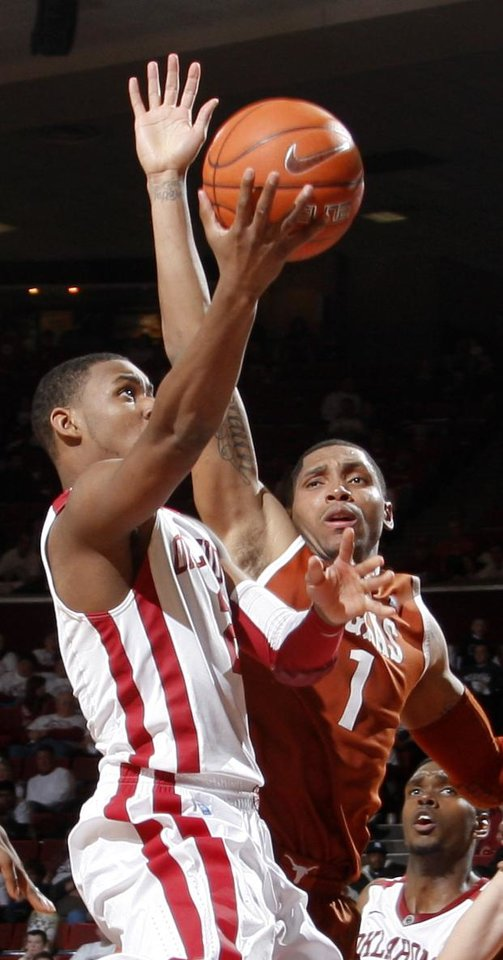 Photo - Oklahoma's Steven Pledger (2) tries to get past Texas' Gary Johnson during the NCAA college basketball game between the University of Oklahoma Sooners and Texas Longhorns at Lloyd Noble Center in Norman, Okla., Wednesday, Feb. 9, 2011. Photo by Bryan Terry, The Oklahoman