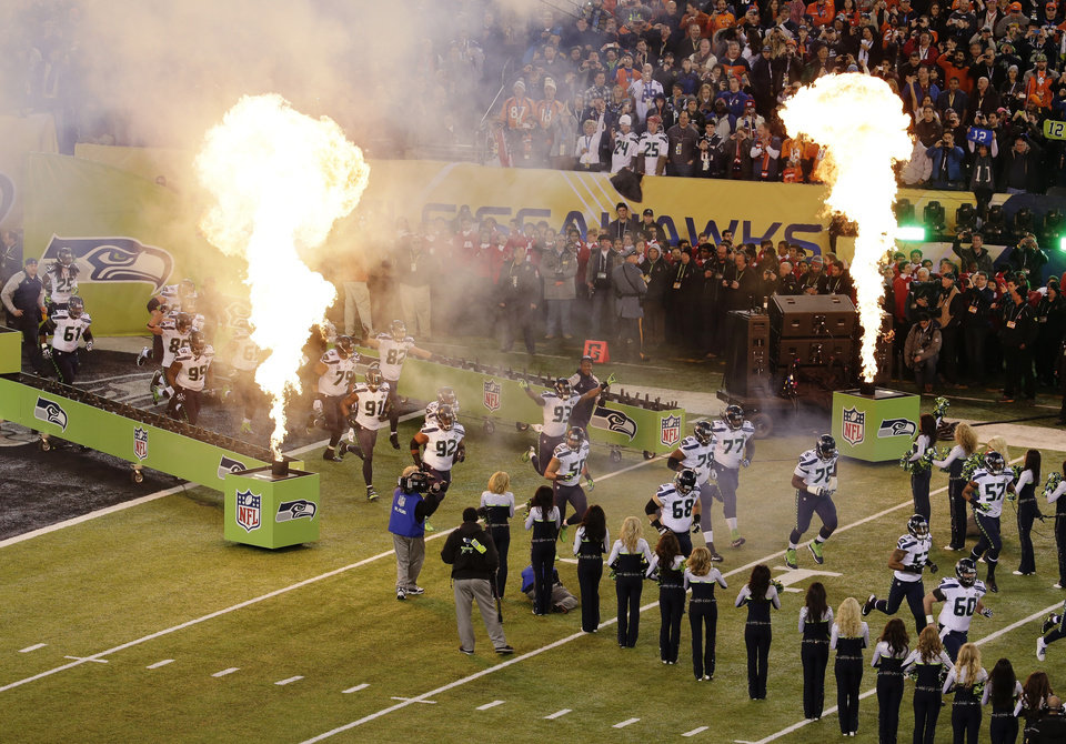 Photo - The Seattle Seahawks run on to the field for the NFL Super Bowl XLVIII football game against the Denver Broncos Sunday, Feb. 2, 2014, in East Rutherford, N.J. (AP Photo/Charlie Riedel)