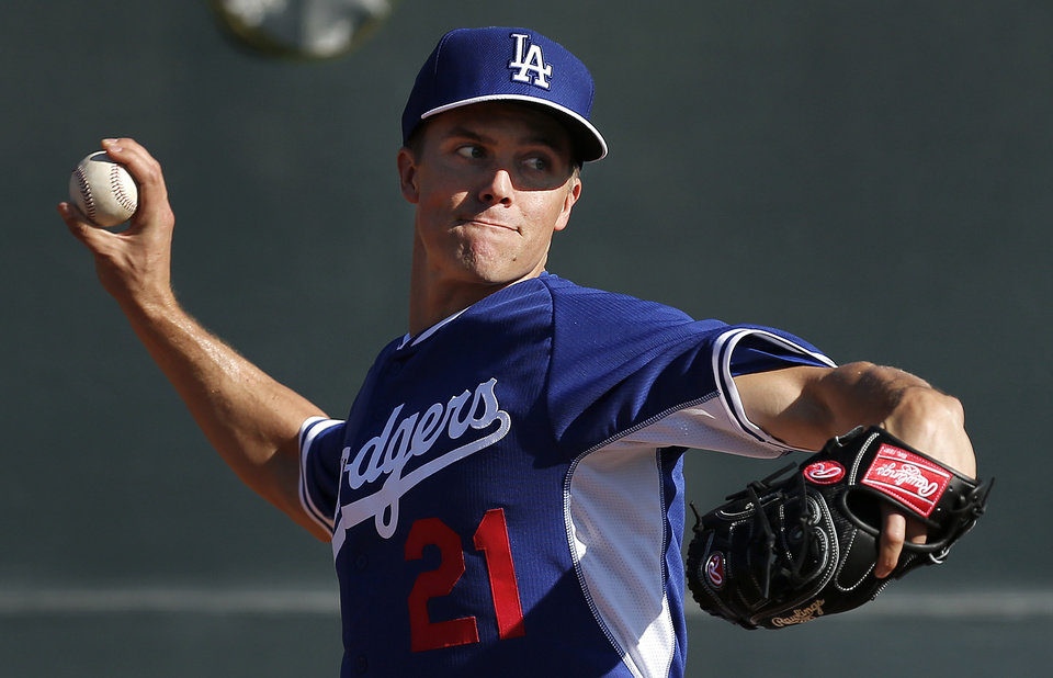 Photo - FILE - In this Monday, Feb. 10, 2014 file photo, Los Angeles Dodgers pitcher Zack Greinke throws during spring training baseball practice  in Glendale, Ariz. Greinke and the Los Angeles Dodgers have knocked Rodriguez and the New York Yankees off baseball's payroll perch. The Dodgers as of Tuesday, March 25, 2014 had a projected payroll of $235 million, according to study of all major league contracts by The Associated Press. (AP Photo/Paul Sancya, File)