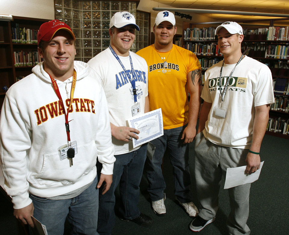 Photo - Norman North High School  players Beau Blankenship, Nathan Badger, Cody Hughes and Tyler Tettleton pose for a photograph after signing letters of intent to play college football at their high school library in Norman, Okla. on Wednesday, Feb. 4, 2009.    Photo by Steve Sisney, The Oklahoman