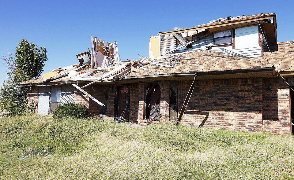 Photo - A home stands damaged from the May 20 tornado at 14509 S Robinson in Oklahoma City.  PAUL B. SOUTHERLAND - The Oklahoman