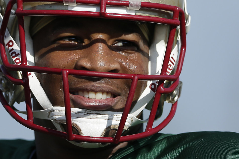Photo - Florida State quarterback Jameis Winston smiles during an NCAA college football practice on Friday, Jan. 3, 2014, in Costa Mesa, Calif. Top-ranked Florida State is to face No. 2 Auburn in the BCS championship game on Jan. 6 in Pasadena, Calif.  (AP Photo/Gregory Bull)