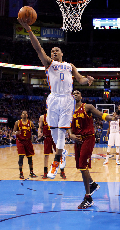 Photo - Oklahoma City's Russell Westbrook (0) goes past Cleveland's Antawn Jamison (4) during the NBA basketball game between the Oklahoma City Thunder and the Cleveland Cavaliers at Chesapeake Energy Arena in Oklahoma City, Friday, March 9, 2012. Photo by Bryan Terry, The Oklahoman