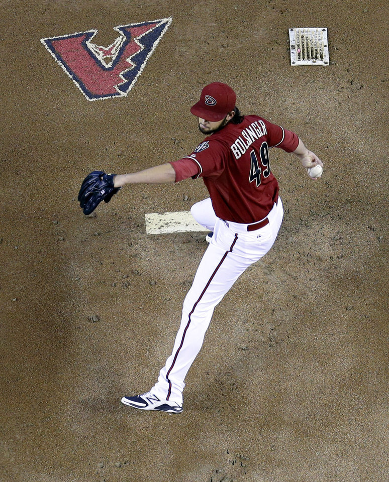 Photo - Arizona Diamondbacks pitcher Michael Bolsinger throws against the San Francisco Giants during the first inning of a baseball game on Sunday, June 22, 2014, in Phoenix. (AP Photo/Matt York)