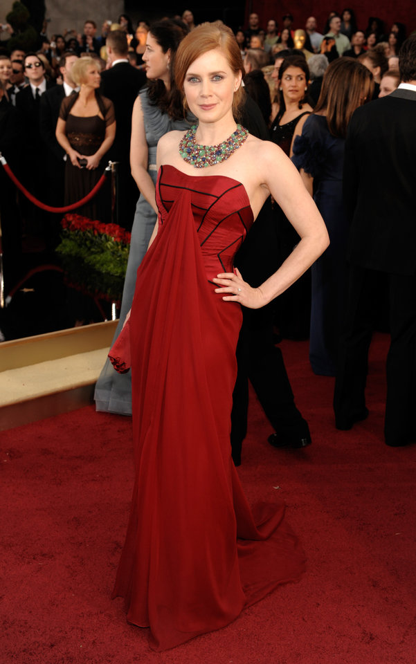 Photo - ** LINDA MILLER'S COMMENTARY:  Wear red if you want to get noticed. Love, love, love that necklace. I'm so buying oversize jewelry this spring.  ** Actress Amy Adams, nominated for an Oscar for Best Actress in a Supporting Role for her work in