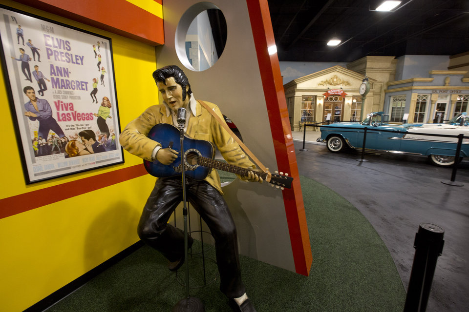 "This Monday, Nov. 26, 2012 photo shows an Elvis Presley lifesize model in a private auto museum in North Palm Beach, Fla. John Staluppi has spent a lifetime selling cars, so successful in his trade he boasts more than two dozen dealerships and more sales than he ever could count. But even he has never seen a sale like this. Staluppi is liquidating his Cars of Dreams Museum and its 115 collector vehicles in an auction Saturday. The Batmobile, the Evel Knievel motorcycle, the lines and lines of perfectly shined cars, all of them will be gone. ""I'm starting to get sad,"" he admits. (AP Photo/J Pat Carter)"