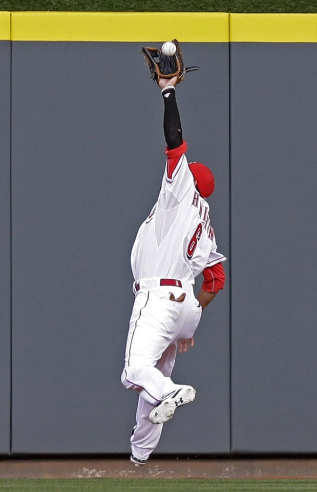 Photo - Cincinnati Reds center fielder Billy Hamilton catches a fly ball hit by Chicago Cubs' Junior Lake in the first inning of a baseball game on Wednesday, April 30, 2014, in Cincinnati. (AP Photo)