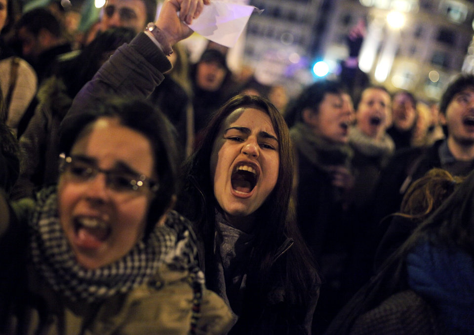 "Protestors shout slogans during a demonstration against corruption in Madrid, Spain, Saturday, Feb. 2, 2013. Spain's governing Popular Party insists its financial accounts are totally legal and denies a newspaper report of regular under-the-table payments to leading members, including current Prime Minister Mariano Rajoy. The scandal first broke when after the National Court reported that former party treasurer Luis Barcenas amassed an unexplained euro 22 million ($30 million) in a Swiss bank account several years ago. In a statement Thursday Jan. 31, 2013, the party denied the existence of ""hidden accounts"" or ""the systematic payment to certain people of money other than their monthly wages."" Spain's top prosecutor says there is sufficient cause to investigate fresh allegations of irregular financing of Spain's governing Popular Party and that if necessary Prime Minister Mariano Rajoy would be called in for questioning. (AP Photo/Andres Kudacki)"