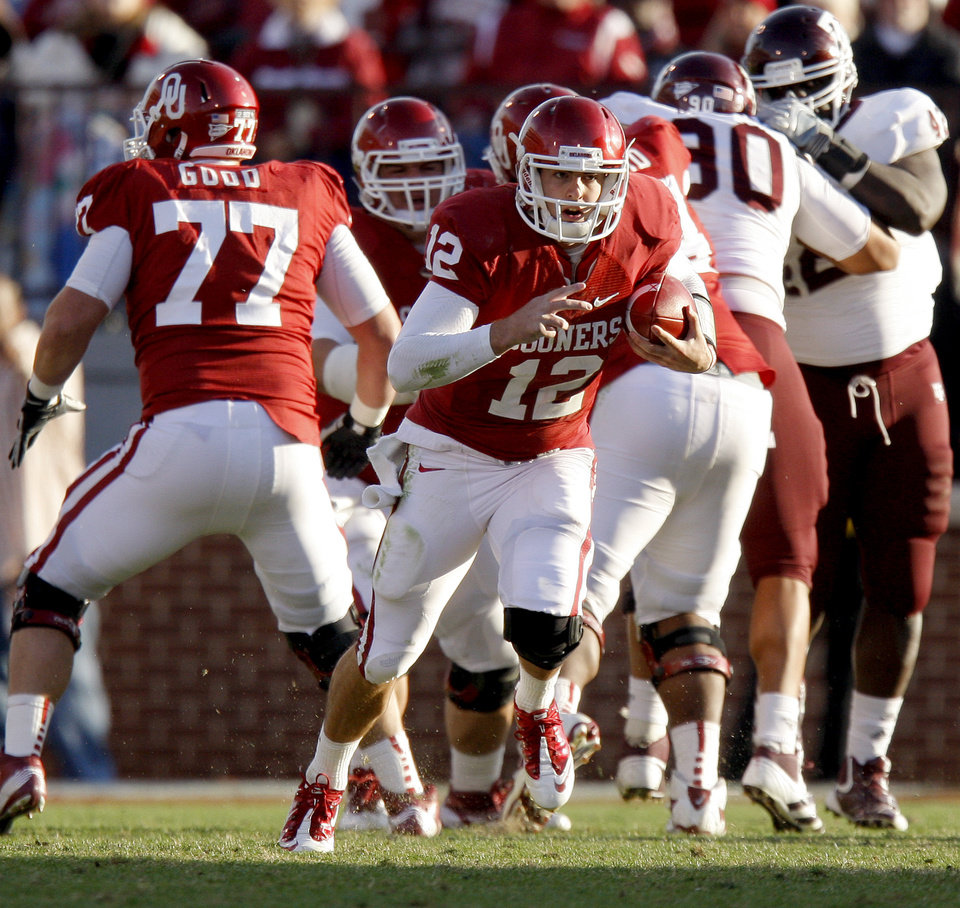 Photo - Oklahoma's Landry Jones (12) runs during the college football game between the Texas A&M Aggies and the University of Oklahoma Sooners (OU) at Gaylord Family-Oklahoma Memorial Stadium on Saturday, Nov. 5, 2011, in Norman, Okla. Oklahoma won 41-25. Photo by Bryan Terry, The Oklahoman