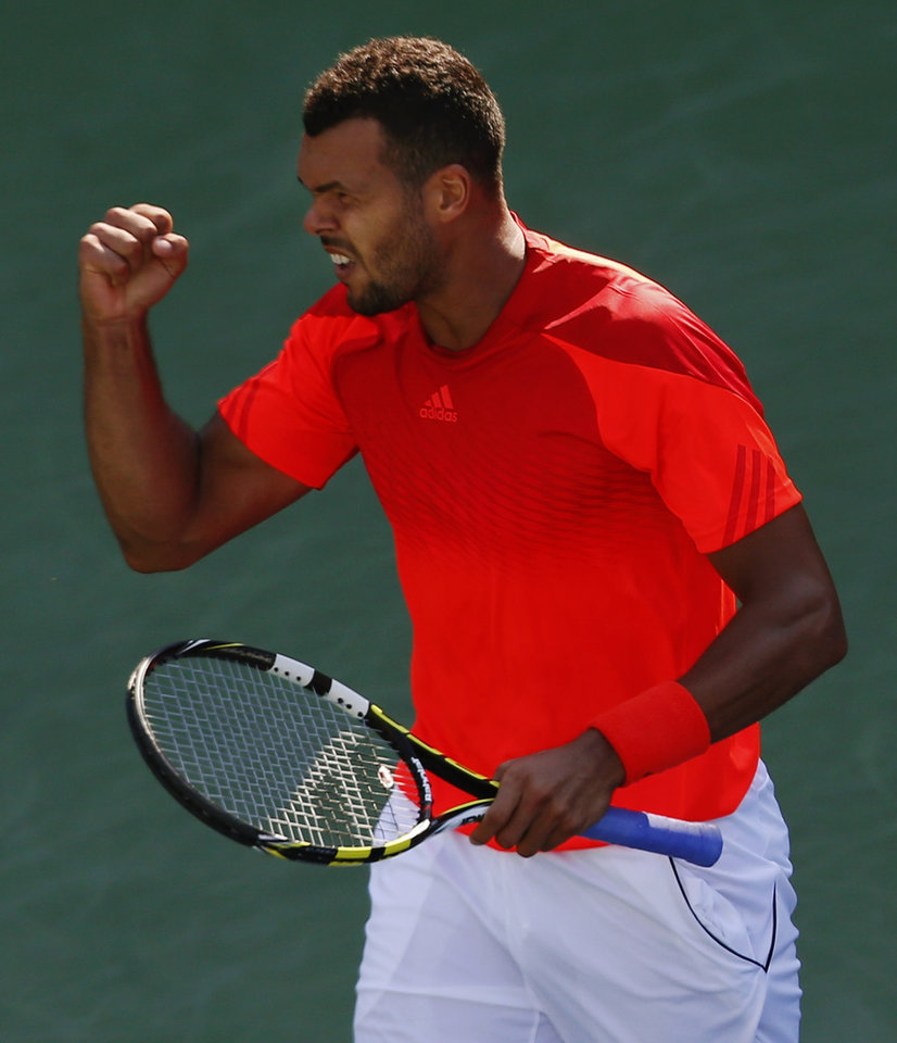 Photo - Jo-Wilifried Tsonga, of France, reacts after a shot against Juan Monaco, of Argentina, during the opening round of the 2014 U.S. Open tennis tournament, Monday, Aug. 25, 2014, in New York. (AP Photo/Matt Rourke)
