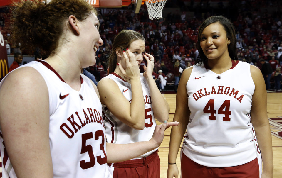 Oklahoma Sooner's Joanna McFarland (53), Whitney Hand (25) and Lyndsey Cloman (44) assemble for the Senior Day ceremony after the University of Oklahoma Sooners (OU) defeated the Kansas Jayhawks 85-77 in NCAA, women's college basketball at The Lloyd Noble Center on Saturday, March 2, 2013  in Norman, Okla. Photo by Steve Sisney, The Oklahoman