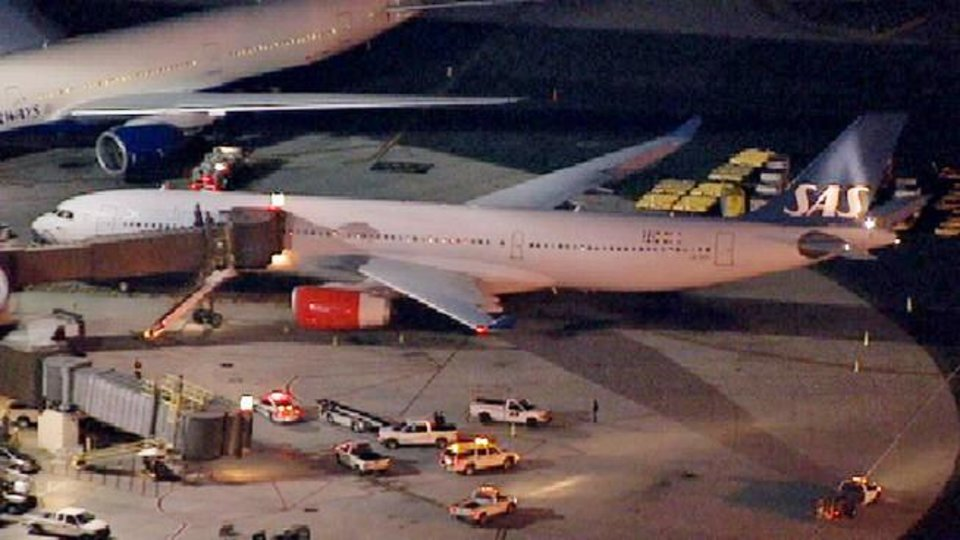 Photo - In this image taken from video and provided by television station WNBC-TV, a damaged SAS Airbus A330 sits on the tarmac at Newark Liberty International Airport after clipping the wing of another aircraft on takeoff, Wednesday, May 1, 2013 in Newark, N.J. Federal Aviation Administration officials say no one was injured in the incident at about 7:30 p.m. (AP Photo/WNBC-TV) MANDATORY CREDIT
