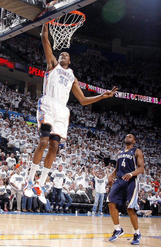 Oklahoma City\'s Kevin Durant (35) dunks in front of Sam Young (4) of Memphis during game five of the Western Conference semifinals between the Memphis Grizzlies and the Oklahoma City Thunder in the NBA basketball playoffs at Oklahoma City Arena in Oklahoma City, Wednesday, May 11, 2011. Photo by Sarah Phipps, The Oklahoman
