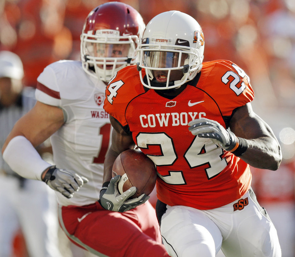 Photo - OSU's Kendall Hunter rushes past WSU defender Alex Hoffman-Ellis during the college football game between the Washington State Cougars (WSU) and the Oklahoma State Cowboys (OSU) at Boone Pickens Stadium in Stillwater, Okla., Saturday, September 4, 2010. Photo by Nate Billings, The Oklahoman