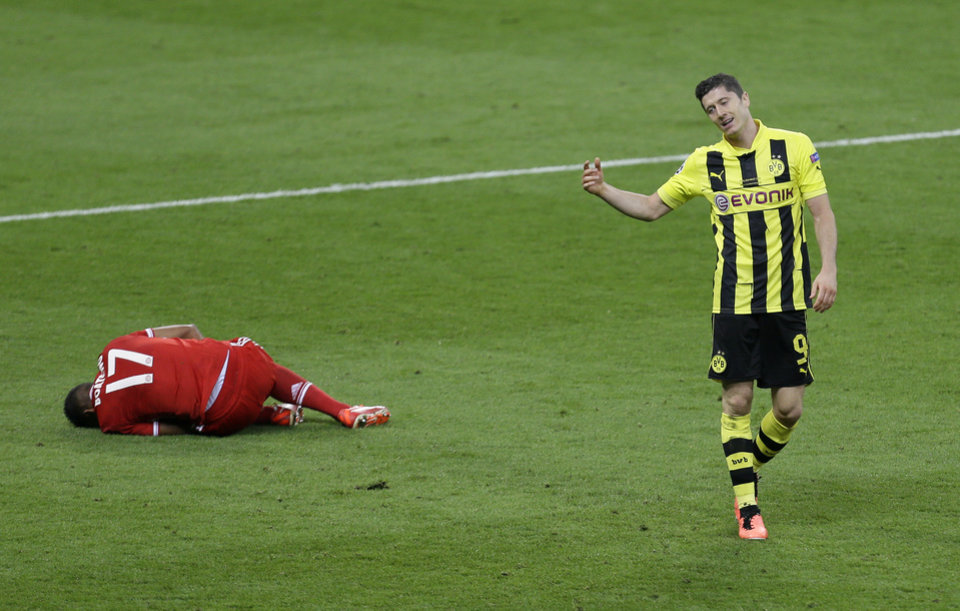 Dortmund's Robert Lewandowski of Poland reacts after fouling Bayern's Jerome Boateng, left, during the Champions League Final soccer match between  Borussia Dortmund and Bayern Munich at Wembley Stadium in London, Saturday May 25, 2013. (AP Photo/Alastair Grant)