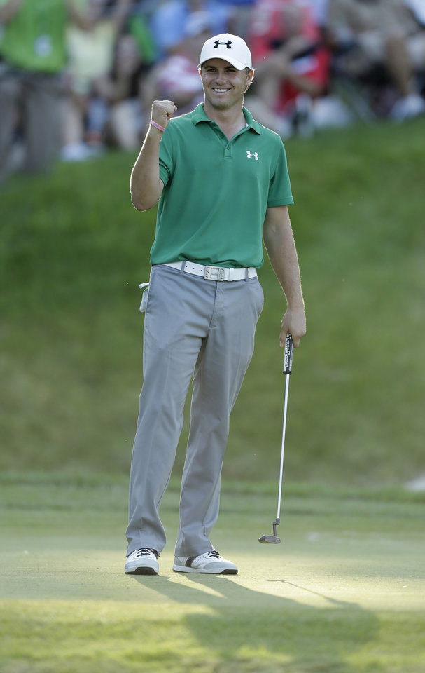 Photo - Jordan Spieth reacts after winning the John Deere Classic golf tournament, Sunday, July 14, 2013, at TPC Deere Run in Silvis, Ill.  Spieth defeated Zach Johnson and David Hearn in a 5-hole sudden death playoff. (AP Photo/Charlie Neibergall)
