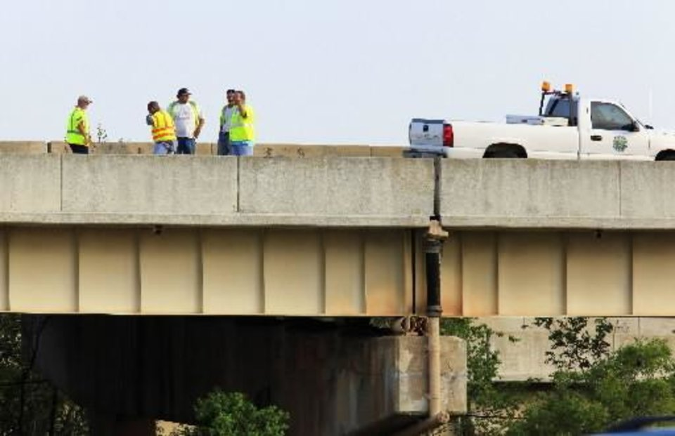 Oklahoma Department of Transportation workers and vehicle in the far left east bound lane of I-44 on the Belle Isle Bridge where it crosses over the NW Expressway in Oklahoma City Monday, July 18, 2011. Two east bound lanes were closed when an expansion joint, shown just right of the center in the photo, failed causing damage to vehicles traveling on the highway. Photo by Paul B. Southerland