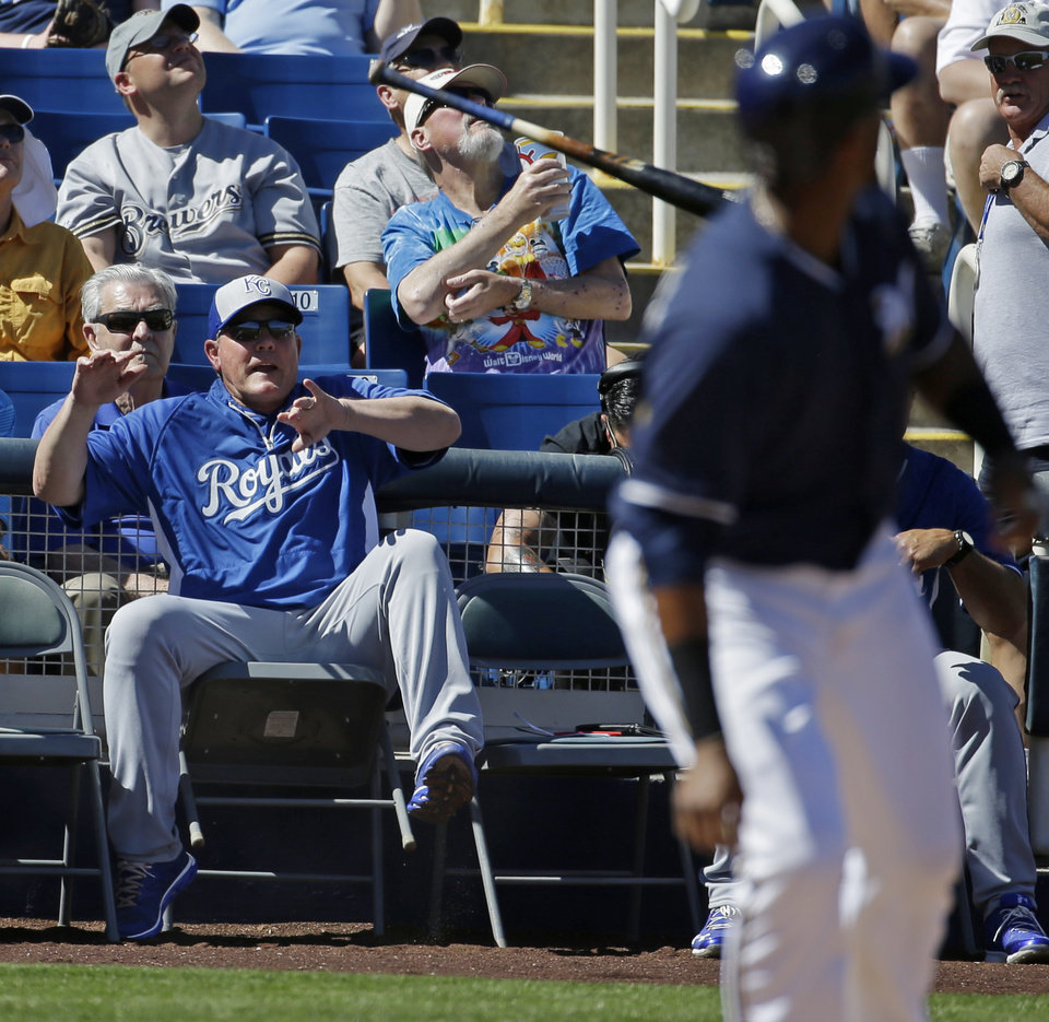 Photo - Kansas City Royals manager Ned Yost reacts as Milwaukee Brewers' Martin Maldonado looses his bat during the first inning of an exhibition spring training baseball game Saturday, March 8, 2014, in Phoenix. (AP Photo/Morry Gash)