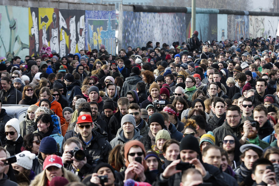 Photo - Thousands of protesters follow a truck with US actor David Hasselhoff as he attends a protest against the removal of a section of the historic part of the East Side Gallery named part of the former Berlin Wall, in Berlin, Sunday, March 17, 2013. Hasselhoff is fondly remembered by many Germans for releasing a song called