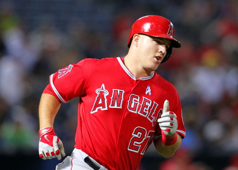 Photo - Los Angeles Angels  Mike Trout (27) rounds first base after hitting a home run in the third inning inning of an interleague baseball game against the Atlanta Braves Sunday, June 15, 2014, in Atlanta. (AP Photo/Todd Kirkland)