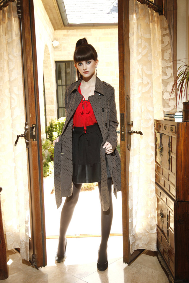 Photo - Red scoop neck blouse by Jade, Very J high-waisted skirt, lightweight dotted trench by Joy Joy and jewelry. Available at Closet Moxie. Makeup by L.J. Hill. Hair by Dianne Truong, Trichology Salon. Photo by Doug Hoke, The Oklahoman     DOUG HOKE