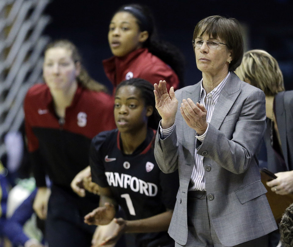 Photo - Stanford head coach Tara VanDerveer, right, applauds from the sideline as her team plays California during the first half on an NCAA college basketball game on Sunday, Feb. 2, 2014, in Berkeley, Calif. (AP Photo/Marcio Jose Sanchez)