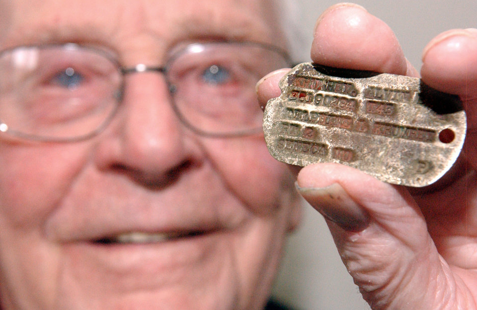 Photo - Alvin Krumley, of Commerce, OK, holds the dog tag that was returned to him after 70 years. PHOTO BY GARY CROW, FOR THE OKLAHOMAN  GARY CROW