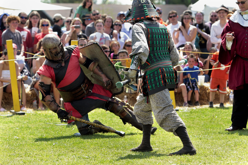 Knight falls during the Medieval Fair on Saturday, March 31, 2012, in Norman, Okla.  Photo by Steve Sisney, The Oklahoman