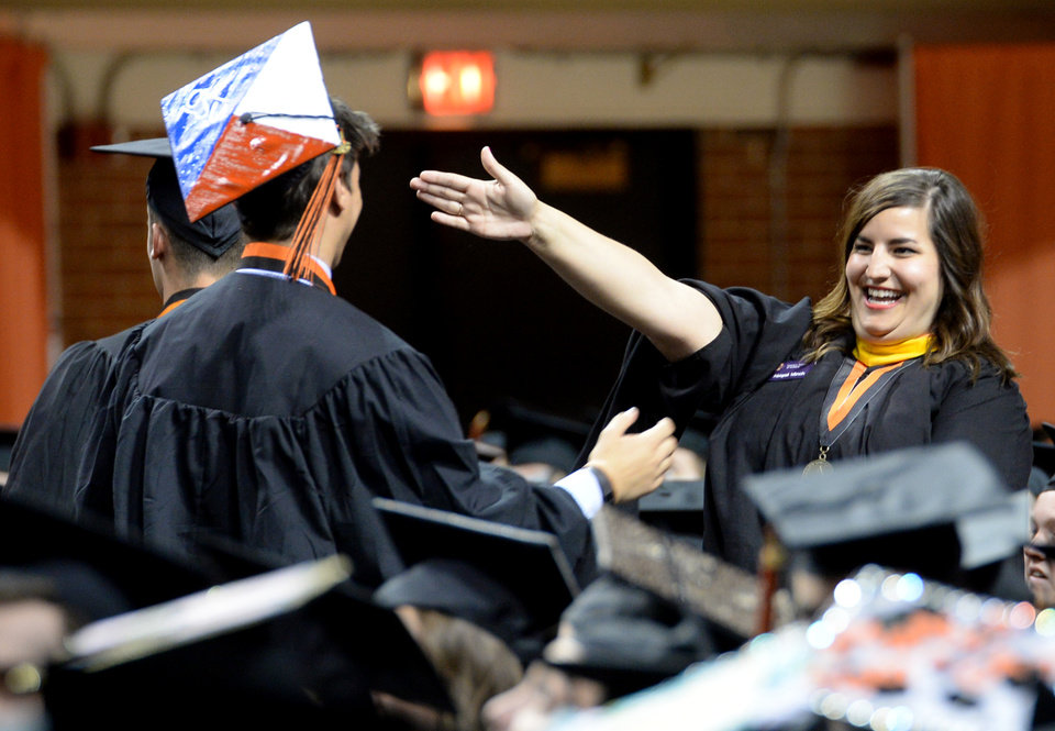 Photo - Students at Oklahoma State University participate in the Spring 2016 commencement ceremony in Gallagher-Iba Arena in Stillwater, Oklahoma on Saturday May 7, 2016. Jackie Dobson for the Oklahoman