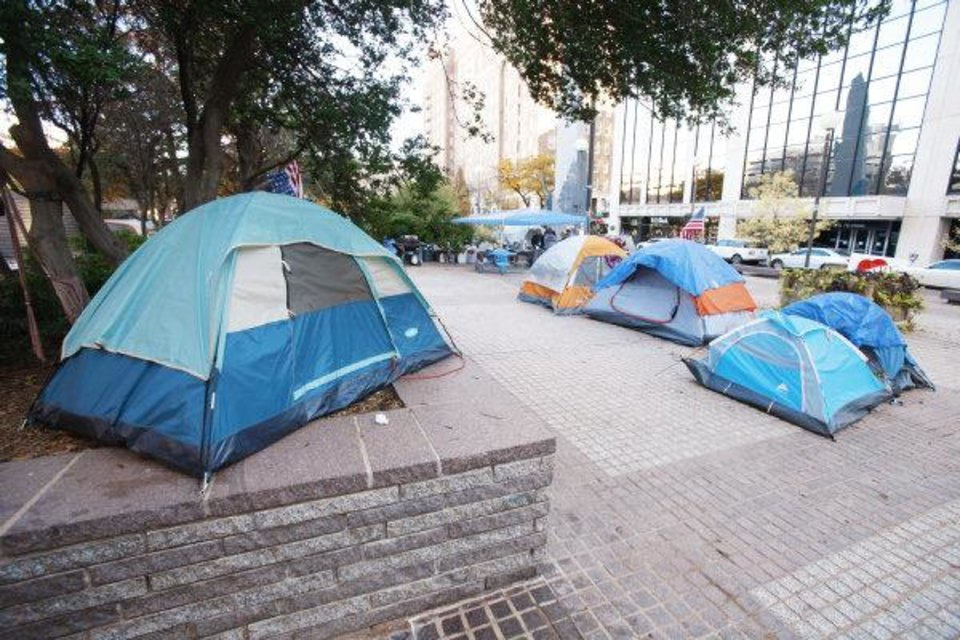 Photo - About a dozen Occupy OKC protesters have been living in a tent city at Kerr Park at Robert S. Kerr and N Broadway avenues in downtown Oklahoma City. PHOTO BY STEVE GOOCH, THE OKLAHOMAN